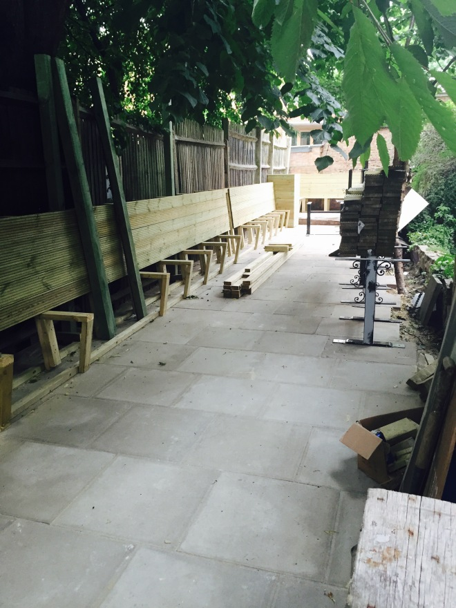In progress - garden cleared, newly paved and fixed booth seating being built